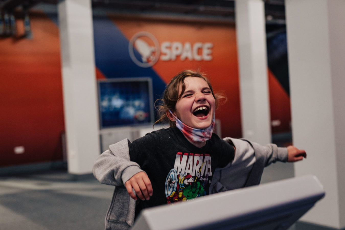 child laughing in Aberdeen Science Centre
