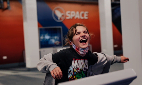 child playing in Aberdeen Science Centre Space Zone