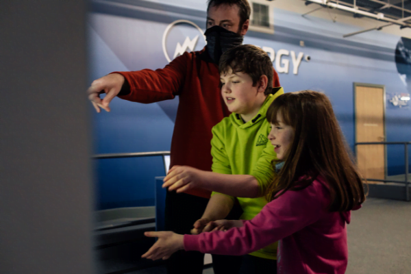 family playing with Aberdeen Science Centre energy zone exhibit